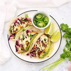 Gluten Free Fish Tacos with Honey Lime Cilantro Slaw - The BEST fish taco recipe! Perfectly cooked fish with an easy cabbage slaw that makes these taste amazing. Slaw For Fish Tacos, Fish Tacos With Cabbage, Healthy Fish Tacos, Easy Fish Tacos, Vegan Tacos, Taco Cabbage Slaw, Grilled Fish Tacos, Salmon Tacos, Dining