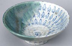 Tea Bowl with Fish Patterns (2011) by Julie Bagish, glazed porcelain