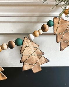 This DIY Wood Burned Christmas Tree Garland takes some common craft items and turns them into charming decor for the Christmas season. Christmas Wood Crafts, Diy Christmas Ornaments, Holiday Crafts, Christmas Time, Diy Christmas Decorations, Bead Garland Christmas Tree, Winter Wood Crafts, Christmas Crafts To Make And Sell, Wood Christmas Tree