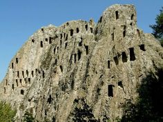 Orlovi skali (Eagle Rocks) near Ardino, Bulgaria. This Thracian sanctuary dates back to 5th or 4th century BC. The complex is a large rock with about 100 trapezoidal niches used for rituals related to the cult of the dead.