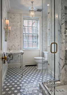 Honeycomb, a natural stone waterjet and hand cut mosaic shown in Calacatta Tia, Bardiglio, and Ming Green, is shown here as a custom bathroom floor.<br /> -Joralemon Street House<br /> Take the next step: prices, samples and design help, http://www.newravenna.com/showrooms/