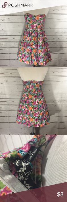 Strapless colorful floral dress. Adorable strapless floral dress with zip up back! Pair it with flats or heels and you are ready to go! Has a little bit of stretch it the bust to make it more comfortable!   Make me an offer & bundle 2 or more items for a deal! I take pride in my closet and love helping out fellow women in the world with affordable items! In the process of adding a TON of new inventory! Every purchase comes with a free gift and a coupon for your next purchase me! feathers…