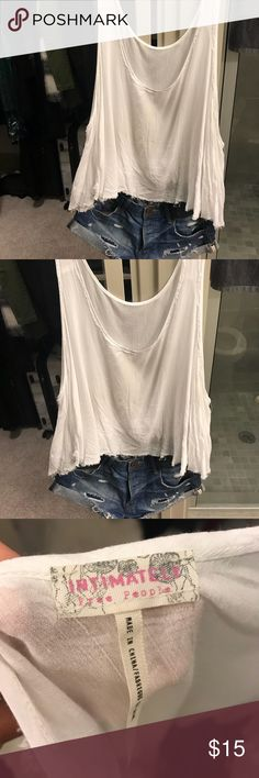 Free People Tank Top white/ off White Free People slowly Tank top with distressed bottom  Cute with jean shorts or as a cover up for a swimsuit top   Gently loved Free People Tops Tank Tops