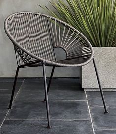 de la sol. Modern aesthetic brings the classic Mexican resort vibe to decks, patios, terraces. Handwoven over powdercoated steel tube frame with patina finish, grey beams of nylon cord radiate a hot spot for hanging out. Full fan-like shape brings graphic lounge chair full circle. CB2 exclusive.