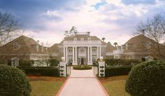 With its columned porch ornate balustrade and rich stucco exterior this luxur Architecture Artists, Architecture Plan, Residential Architecture, Luxury House Plans, Dream House Plans, Woodworking Outdoor Furniture, Palladian Window, Stucco Exterior, Colonial Exterior