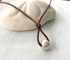 A personal favorite from my Etsy shop https://www.etsy.com/listing/549387321/leather-pearl-necklace-single-freshwater