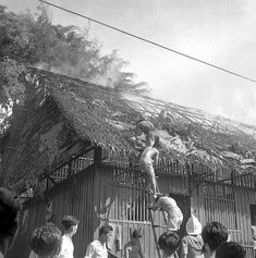 FIRE AT NO 7-A KAMPONG IN HENDERSON - VILLAGERS CLIMBING …