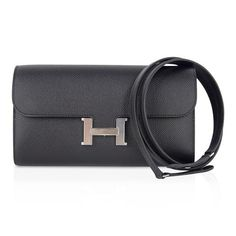 Guaranteed authentic coveted Hermes Constance To Go features classic Black with Palladium Hardware.Rich in Epsom...