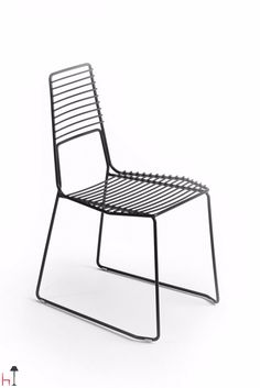 The Alieno chair by Casamania is available in painted metal and is suitable for outdoor use.