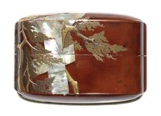 An inlaid tan lacquer single-case inro By Tatsuke Takayoshi, 19th century