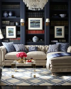 Love the navy bookshelves with the sconces built into the moldings.  Great sofa too! Warner Linen Sectional Sofa - Horchow