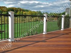 Best Trex Spiced R*M Decking With White Post Sleeves And Black 400 x 300