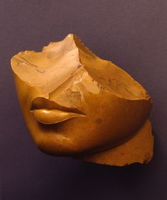 Fragment of the face of a queen, yellow jasper, c. 1353–1336 B.C. Middle Egypt