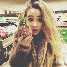 Sabrina with a small pineapple