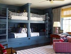 This nautical-inspired bunk room in a Hamptons home by Steven Gambrel features lots of room for storage with built-ins and under-bed drawers. Custom netting provides safety for the top bunks. Double Bunk Beds, Bunk Beds Built In, Twin Beds, Built In Beds For Kids, Double Twin, Cool Boys Room, Boy Room, Child's Room, Bedroom Ideas