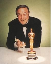 Gene Kelly and his replacement Oscar(the original 1951 Oscar was destroyed in a fire in 1983)