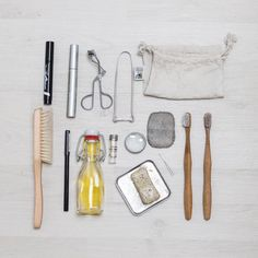 Zero waste, plastic-free toiletries: bamboo toothbrushes, face oil, dental lace compostable dental floss, bar soap in a travel tin, and more