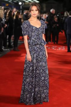 For the premiere of her new film, [i]The Light Between Oceans[/i], Alicia Vikander wore florals, modernised. The Louis Vuitton gown featured the puff sleeves and ruffle styles we've seen in recent shows. Alicia Vikander Style, Alicia Vikander Oscars, Louis Vuitton Dress, Nice Dresses, Dresses For Work, Maxi Dresses, Latest Celebrity Gossip, Jason Bourne, Glamour Uk