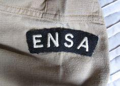 E.N.S.A. cloth arc title