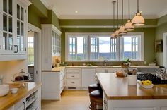 The green paint seems to actually work here, plus the windows echo the glass fronts of the cabinets