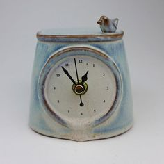 This clock measures 5 x 5 x 4.5 tall.  It was handmade in red clay and decorated with lead-free glazes. The mechanism is non-ticking so the