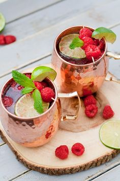 Vodka with spicy ginger ale, fresh lime juice & sweet, tart raspberries served in copper mugs. This Raspberry Moscow Mule is a perfect easy summer cocktail