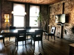 Simple boardroom table & chairs; it's the room's wood & brick walls that speak up in this meeting room.