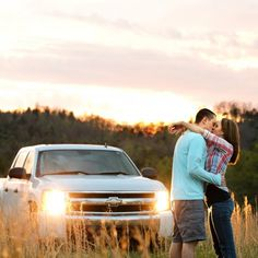 A country engagement session filled with cowboy boots, baseball, a truck, and lots of love!