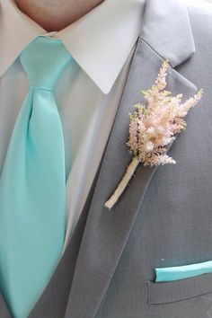 Astilbe boutonniere for a groomsmen.