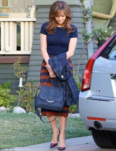 Jennifer Lopez between takes, while filming 'The Boy Next Door', in Los Angeles. Lovely navy and brown-red striped skirt, with navy short sleeve jumper. (in Nov 2013)