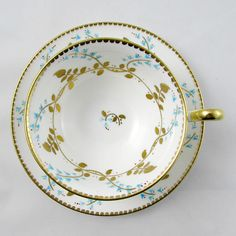 Royal Chelsea tea cup and saucer, white with gold leaves and blue flowers and gold trimming on the cup and saucer edges. Excellent condition (see photos). Markings read: Royal Chelsea English Bone China Made in England Please bear in mind that these are vintage items and there may be