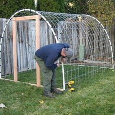 I like this simple greenhouse. step by step DIY greenhouse http://homesteadsurvival.blogspot.com/2012/07/step-by-step-greenhouse-diy-project.html
