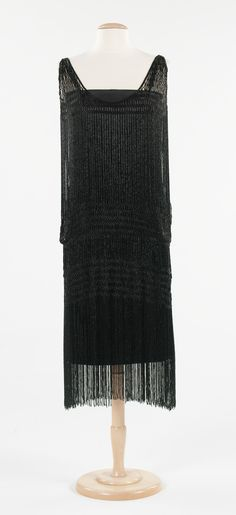 "Evening Dress, Gabrielle ""Coco"" Chanel (French, Saumur 1883–1971, Paris) for the House of Chanel (French, founded 1913): ca. 1924-1926, French. ""...While Chanel introduced the concept of the ""little black dress"" into fashion vocabulary, this example shows just how refined and varied the examples she designed could be. Here, strands of beads join to form an interlace pattern that defines the bust, the dropped waist and the dropped hipline..."""