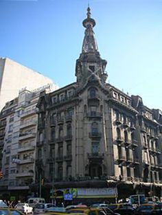 The Confitería El Molino, a favorite meeting place for local cultural, business and political figures, is an Art Nouveau style coffeehouse located on the busy corner of Callao and Rivadavia Avenues, across from the Argentine National Congress. Finished 1n 1917, its corner turret illuminated with electric lighting featured stained glass windows and decorative windmill sails. In 1997 the café closed and was declared a national monument. It is in urgent need of repair.