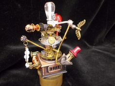 The Whirling Dervish-- Steampunk Miniature Rotating Carousel Sculpture. $69.99, via Etsy.