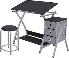 Economical, convenient, and stylish, the Studio Designs Comet Center with Stool - Silver/Black 13325 creates a comfortable work space and keeps supplies. Big Desk, Desk Set, Wood Drafting Table, Solid Wood Desk, Desktop Storage, Work Station Desk, Table Frame, Desk With Drawers, Storage Drawers