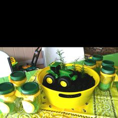 Centerpieces for John Deere birthday party. The jars have homemade green and yellow playdoh that the kids were able to take home as party favors...