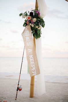 """""""She's a keeper"""" banner at this beach wedding  Photography: Becca Borge Photography - beccaborge.com  Read More: http://www.stylemepretty.com/southeast-weddings/2014/04/22/florida-keys-beach-wedding-at-drop-anchor-resort/"""