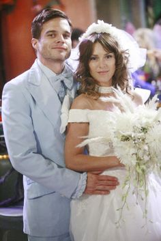 Greg Rikaart and Elizabeth Hendrickson    AKA Kevin and Chloe Fisher. Their first wedding.