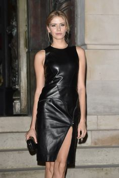 It Girl Elena Perminova wore a black leather Versace dress with a zipper detail at the side