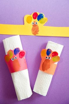 Thanksgiving Activities for Preschoolers including turkey fingerprint napkin holders, a free printable and more!