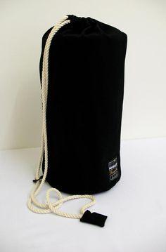 "image: Virginia Walker - luxury packaging for ""Tranquilitie"" 100% Wool Luxury Blankets - www.tranquilitie.com - luxury interior style - canvas duffel drawstring bag"