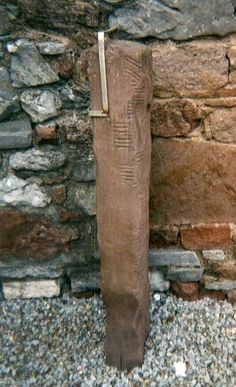 """Ogham stone at Rathass Church in Tralee County, Kerry, in the southwest of Ireland. It measures 52.75"""" (134 cm) x 11.81"""" (30 cm) x 7.48"""" (19 cm) with an inscription : [.]NMSILLANNMAQFATTILLOGG interpreted as : [A]NM SILLAN MAQ FATTILLOGG - Image : © Jaqian / April 6, 2009"""