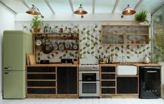 Our Rio adjustable industrial wall lights have a unique design that accent this vintage-style kitchen in this Hackney House, London. Kitchen Furniture, Kitchen Interior, Industrial Style Kitchen, Modern Industrial, Modern Retro Kitchen, 60s Kitchen, Timber Kitchen, Plywood Kitchen, Kitchen Contemporary