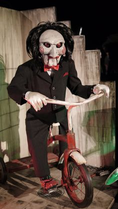 Billy the Puppet - Saw franchise Kick him off his bike and run!