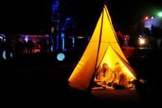 At the Hennessy V.S. Presents Details at Midnight event at Coachella, guests gathered in a tricked-out teepee.