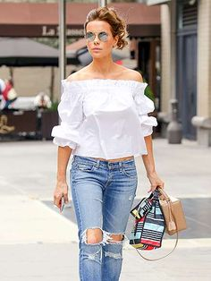 The always-chic Kate Beckinsale pairs distressed denim with an off-the-shoulder top as she makes her... - Splash News Online