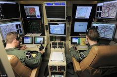 On the look out: Drone pilots use a bank of high-resolution screens which play in real time images from the aircraft.