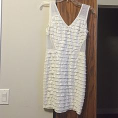 White and silver bodycon dress White dress with ruffle silver snake look print. Sheer/netted cut out sides. Great condition worn once. Dresses