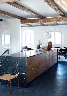 Kate Monckton - I like the idea of including modern design within a period property. The architectural slabs of marble that wrap around the wooden body of the kitchen island work well against the backdrop of the farmhouse interior. Country Kitchen, New Kitchen, Kitchen Decor, Kitchen Black, Loft Kitchen, Island Kitchen, Kitchen Styling, Rustic Kitchen, Marble Kitchen Ideas